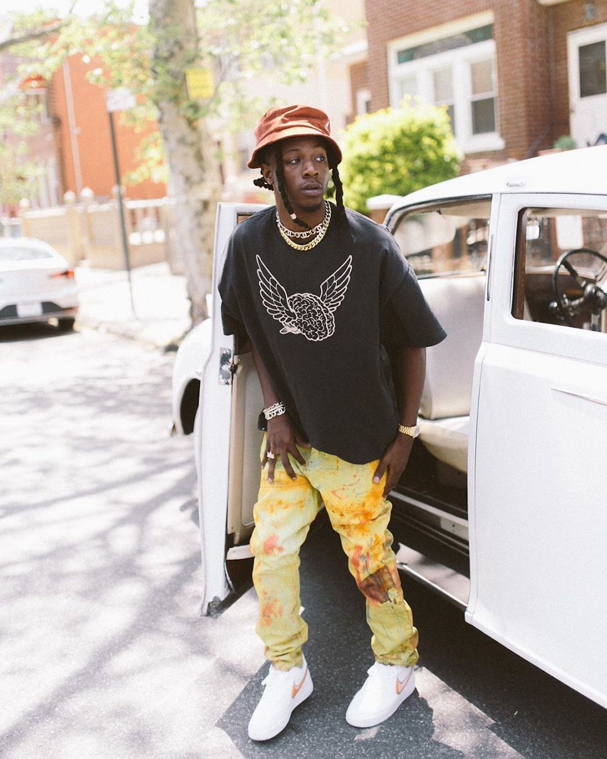SPOTTED: Joey Badass Dons Bold Yellow Trousers & Bucket Hat in NYC